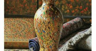 A Paper mache vase evoking the mood of festive decorating.